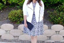 13 a printed knee dress, blackstrappy heels, a white biker-style jacket, a black clutch