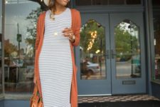 13 a striped bodycon midi dress, a rust long cardigan, a rust bag, a hat and white strappy heels