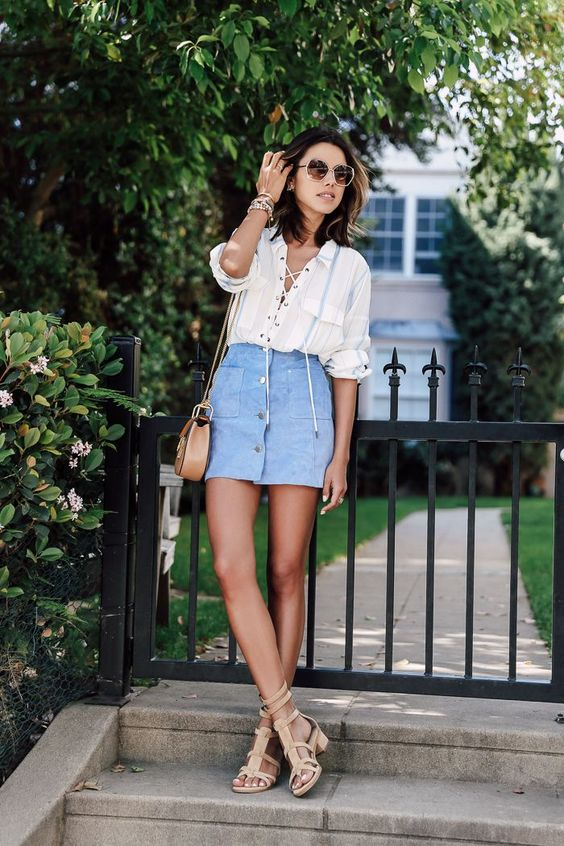 a striped lace up shirt, a pastel blue button down skirt, nude sandals and a tan bag