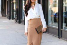 13 a white shirt, a tan asymmetrical midi skirt, nude shoes and a leopard print clutch