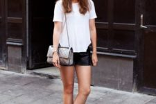 13 a white tee, blackleather shorts, black leather shoes and a silver  bag
