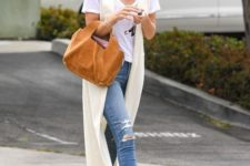 13 a white tee, blue ripped skinnies, a creamy duster vest, beige suede boots and a camel bag