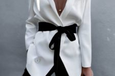 13 black pants, a white blouse with a blakc velvet sash and a deep neckline, which is sexy