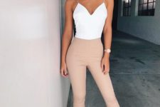 13 blush high waist pants, a white spaghetti strap top, white heels for a sexy look