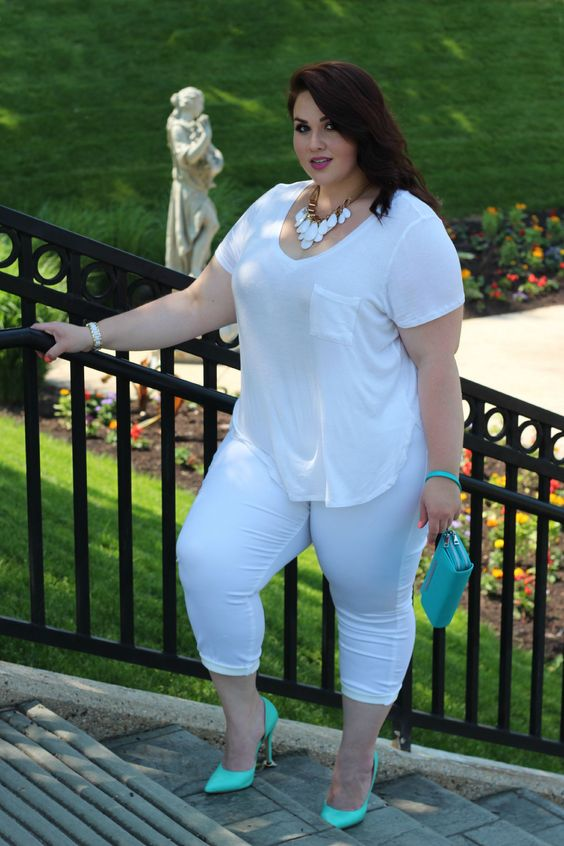 white leggings, a white tee,, a statement necklace, neon green shoes and a green clutch