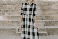 14 a buffalo plaid black, grey and white midi dress, tan booties and a black hat for the transition