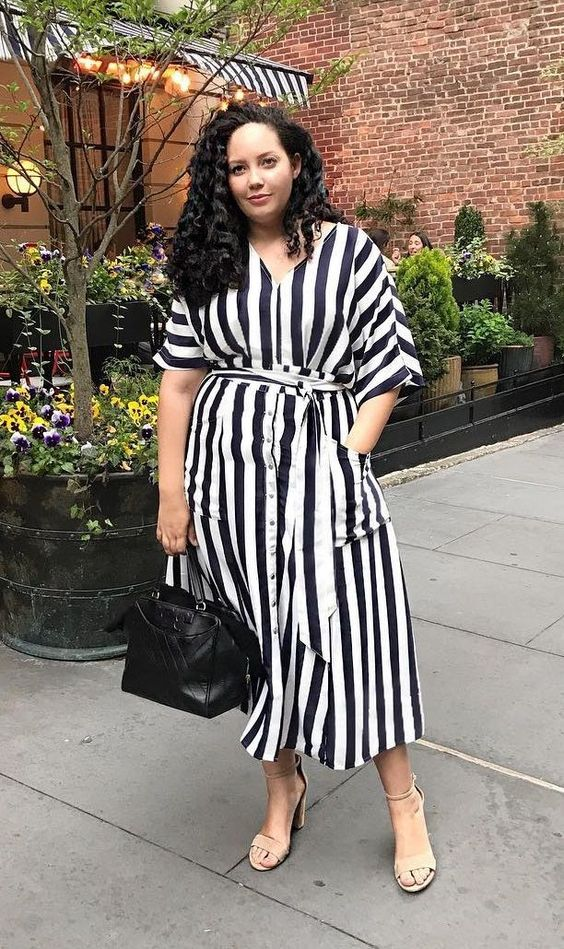 a striped black and white midi dress, a black bag, nude shoes for a simple look