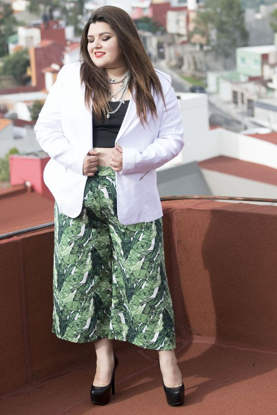 a trendy look with tropical leaf print culottes, a black crop top, a white jacket and black heels