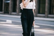 14 a white ruffled top, black high waisted pants, black shoes and a bag for a minimalist look