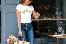 14 a white tee, blue raw hem jeans, strappy wedges and astraw bag