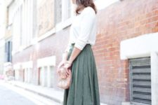 14 a white top, a green pleated midi, nude strappy heels and a sparkly bag