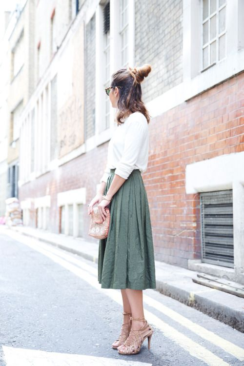 a white top, a green pleated midi, nude strappy heels and a sparkly bag