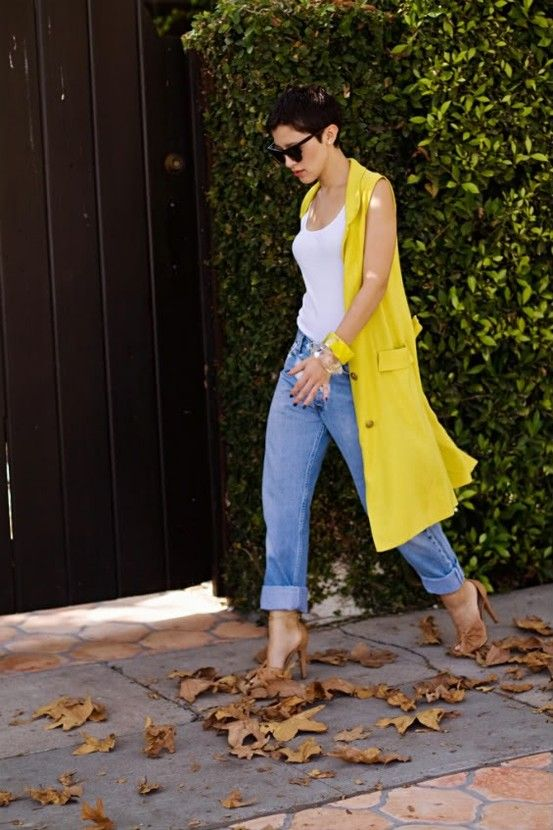 a white top, blue boyfriends, a neon yellow duster vest and tan heels for a bright look