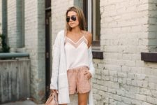 14 blush shorts, a white spaghetti strap top, grey booties and a creamy cardigan