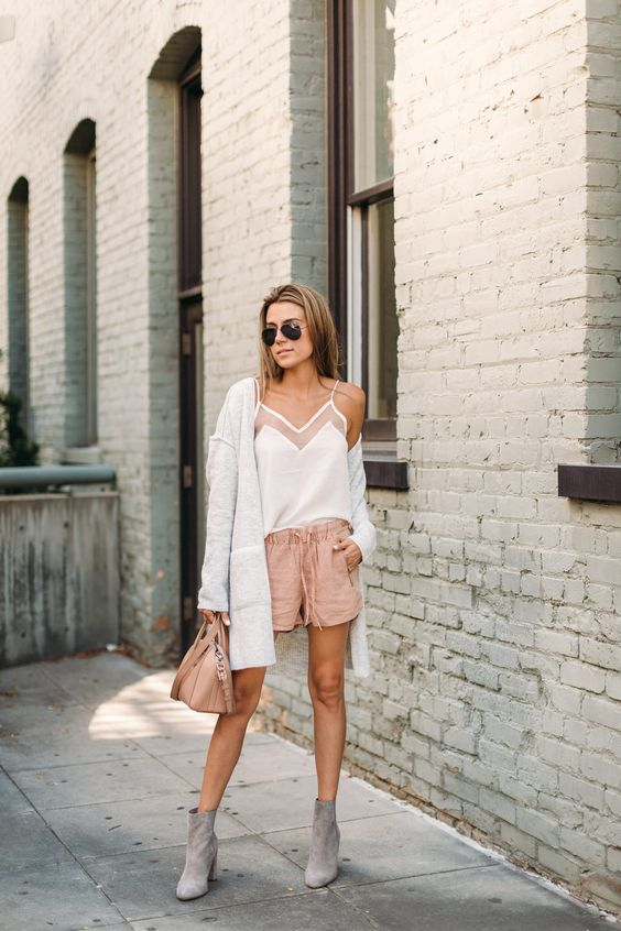 blush shorts, a white spaghetti strap top, grey booties and a creamy cardigan