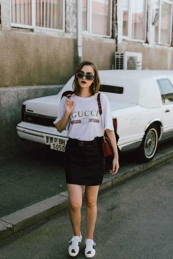whimsy heart sneakers, a black skirt, a Gucci t-shirt and cool sunglasses for a badass look