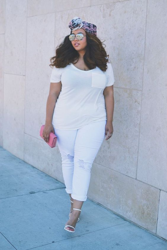 white ripped jeans, a white tee with a pocket, white heeled sandals and a pink clutch