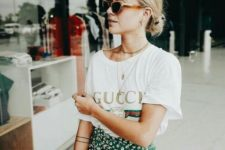 15 a Gucci tee, a green floral print midi and a mall clutch for a relaxed look