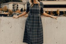 15 a dark plaid midi dress with short sleeves, amber mules and a hat for a chic vintage-inspired look