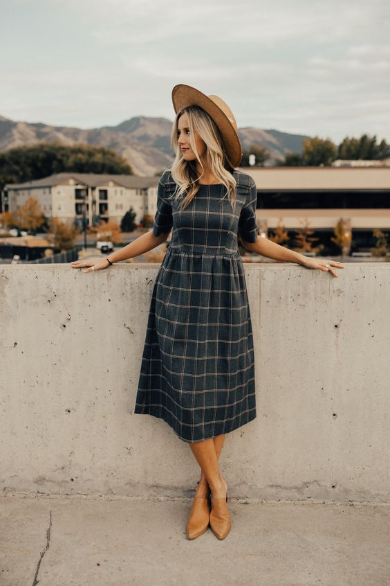 a dark plaid midi dress with short sleeves, amber mules and a hat for a chic vintage-inspired look
