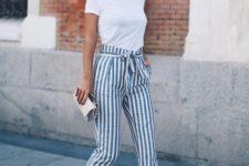 15 a white tee, high waist striped pants, tan shoes and a clutch