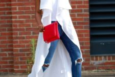 15 blue ripped skinnies, a white top, a white duster vest, yellow shoes and a red clutch