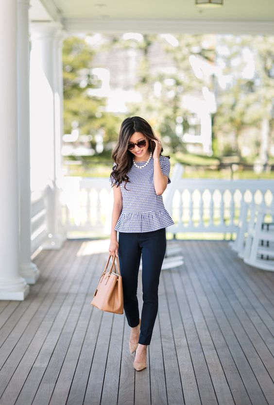 navy pants, a blue gingham ruffle top, nude shoes and a bag plus a strand of pearls