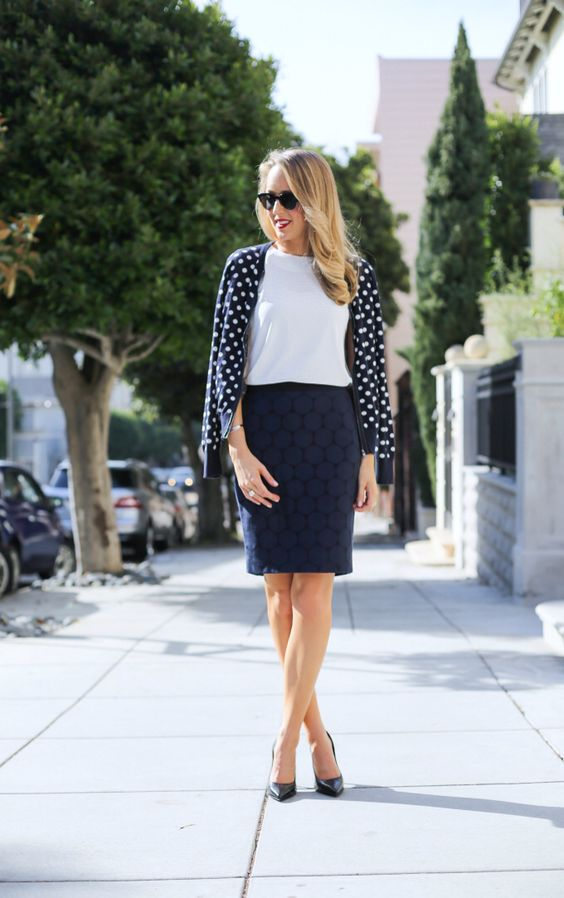 a white top, a polka dot shirt, black shoes and a navy pencil skirt