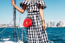 16 an off the shoulder buffalo plaid black and white midi dress, black lace up sandals and a red bag