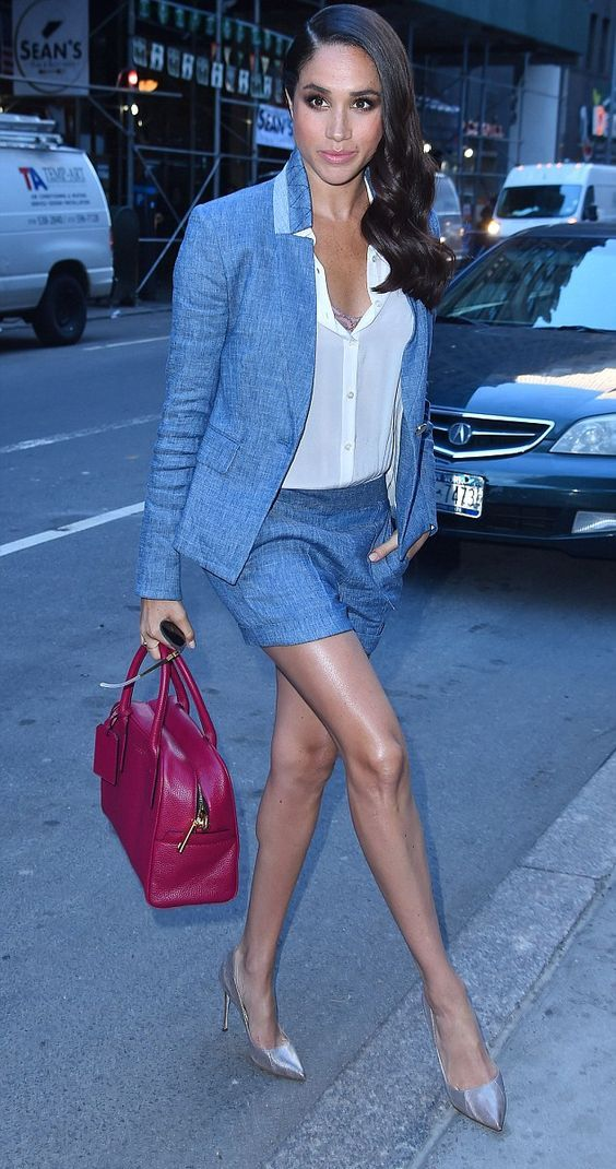 show off your legs wearing a grey suit with shorts, metallic pumps and a bright bag like Meghan Markle