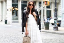 16 style a white lace dress with black heeled sandals, a black leather jacket and a neutral bag