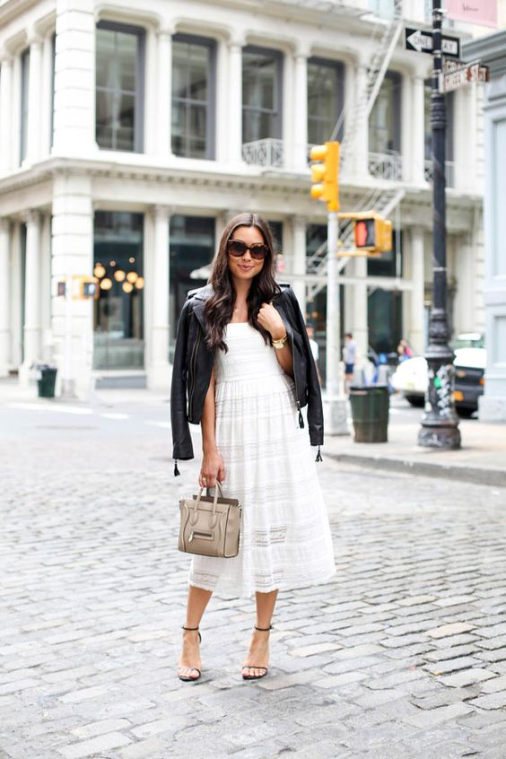 style a white lace dress with black heeled sandals, a black leather jacket and a neutral bag