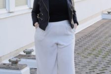 16 white culottes, a black tee, a black denim jacket, black shoes for a chic fall look