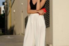 16 white culottes, a black thick strap top, a small red clutch, black fringe shoes