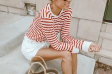 16 white shorts, a striped long sleeve, strappy sandals and a straw bag for a transitional coastal look