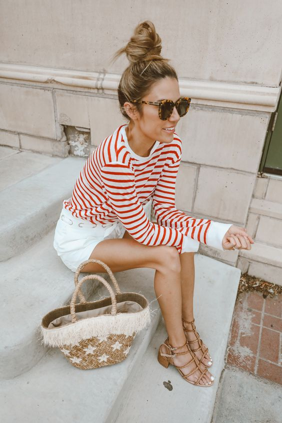 white shorts, a striped long sleeve, strappy sandals and a straw bag for a transitional coastal look