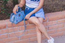 16 white sneakers, a white logo tee, a denim mini skirt and a blue bag