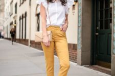 16 yellow cropped pants, a white blouse with ruffled sleeves, nude shoes and a neutral bag