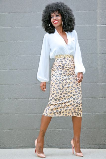 With animal printed midi skirt and beige pumps