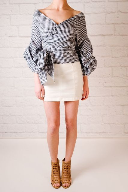 With beige mini skirt and brown shoes