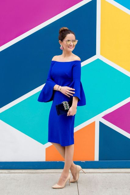 Cobalt blue dress with beige pumps and black clutch