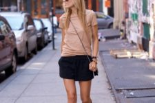 With beige shirt, black shorts and crossbody bag