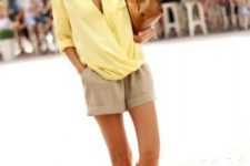 With beige shorts, brown bag and flats