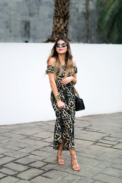 With black bag, sandals and sunglasses