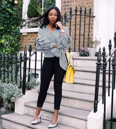 With black crop pants, yellow bag and white pumps
