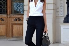 With black crop trousers, mini bag and heels