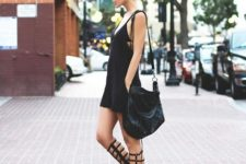 With black dress and black leather bag