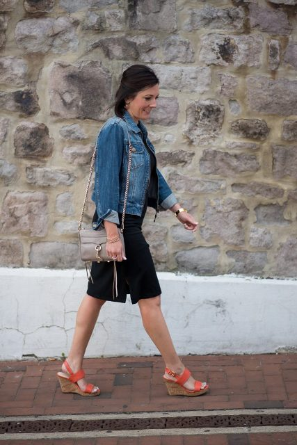 An outfit with two tones sandals, black dress, gray bag and denim jacket