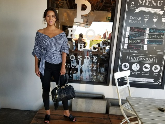 With black leggings, black bag and flat sandals