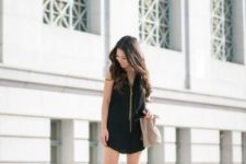 With black mini dress and gray bag